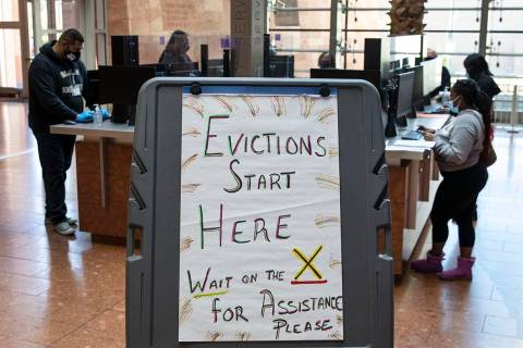Tenants, who received an eviction notice from their landlord, fill out forms at the Civil Law S ...