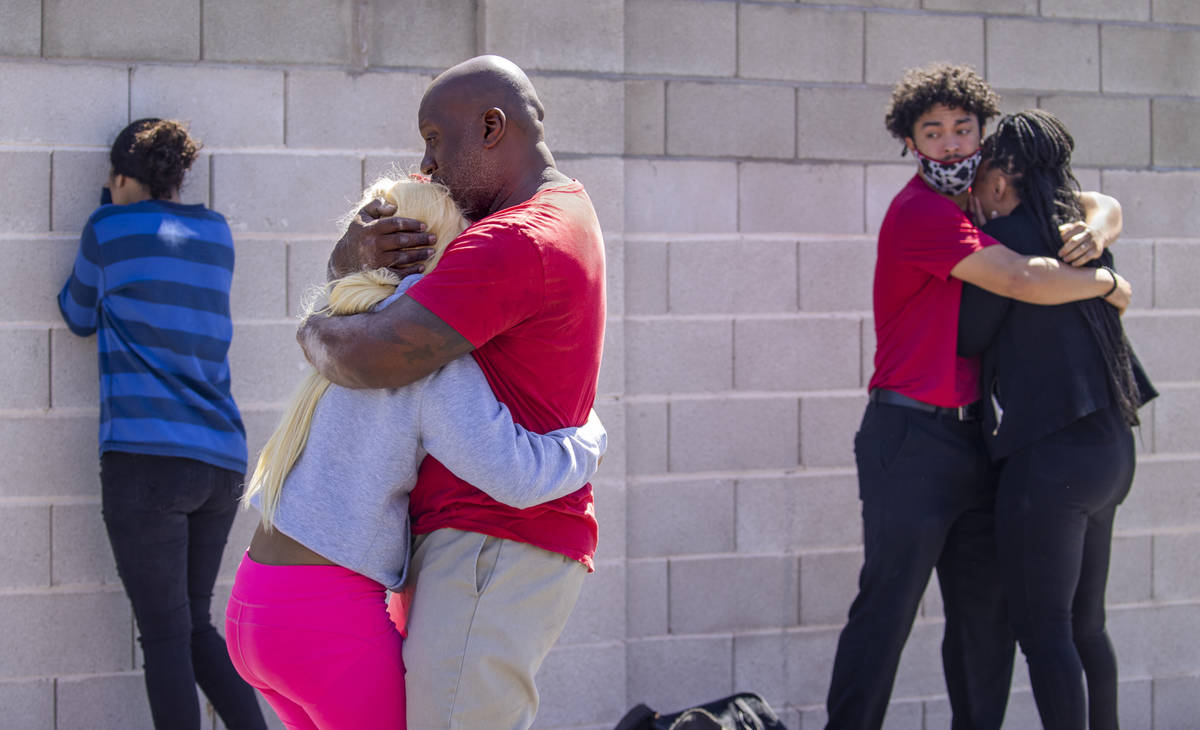 Family members reunite and console each other near where the Clark County Fire Department works ...