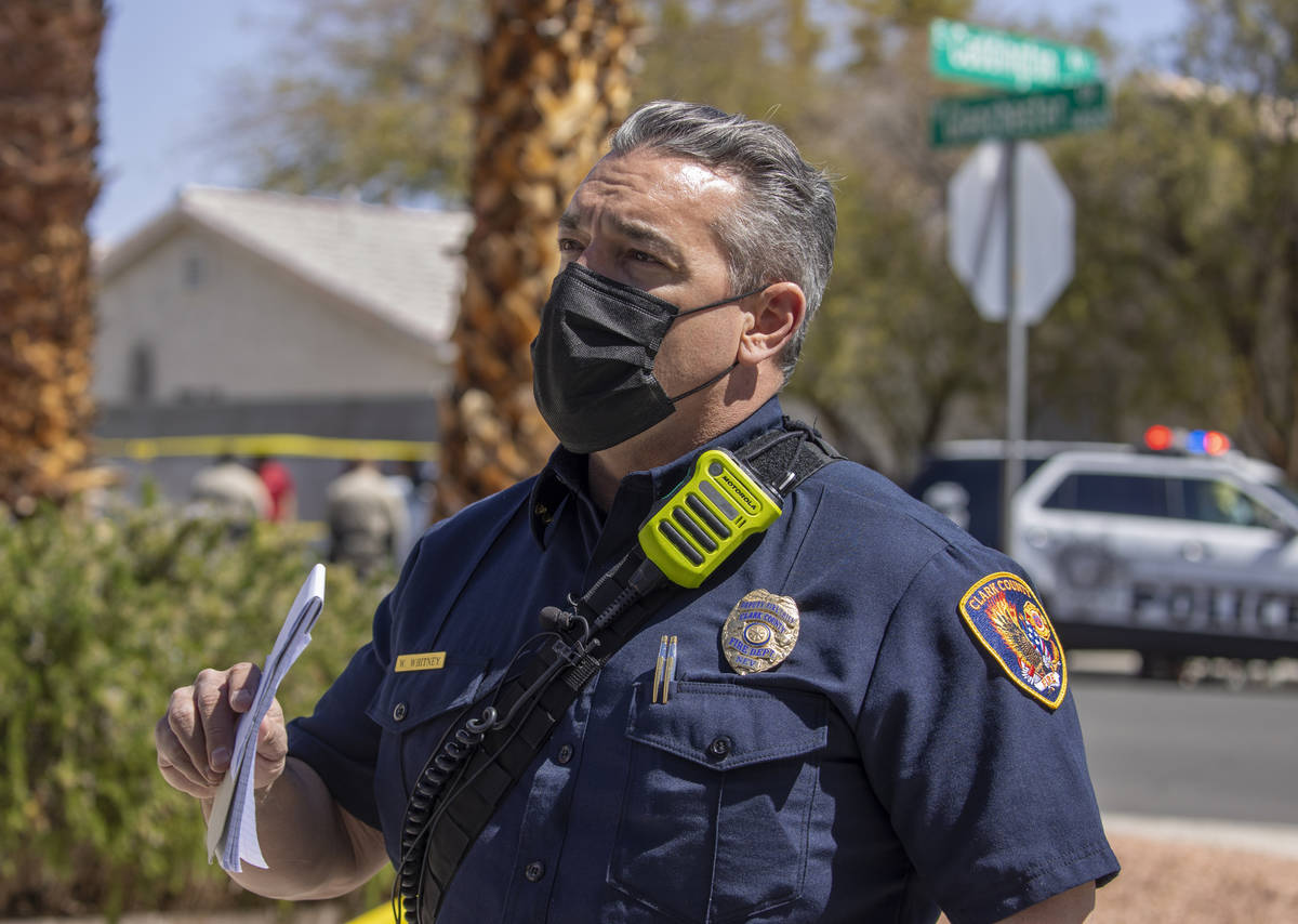 Clark County Fire Department Deputy Fire Chief Warren Whitney talks about a house fire along th ...