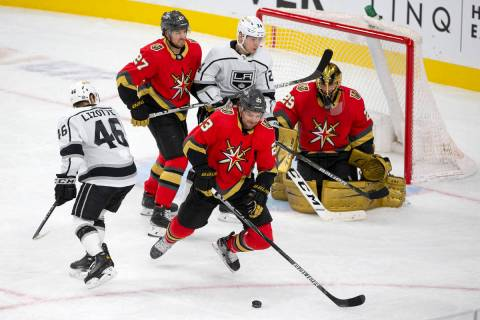 Golden Knights defenseman Alec Martinez (23) skates for the puck after an attempted goal by the ...