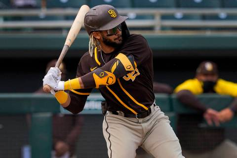 San Diego Padres' Fernando Tatis Jr. hits against the Oakland Athletics during the first inning ...
