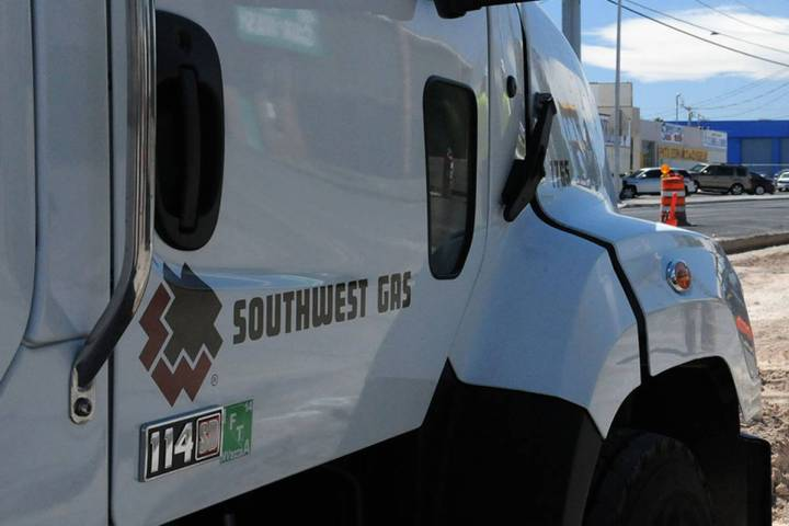 Construction crews with Southwest Gas and ELM Locating and Utility Services work to repair a ga ...