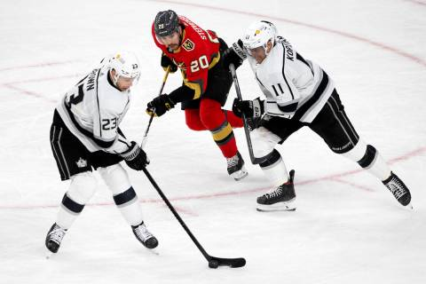 Kings right wing Dustin Brown (23), Golden Knights center Chandler Stephenson (20) and Kings ce ...