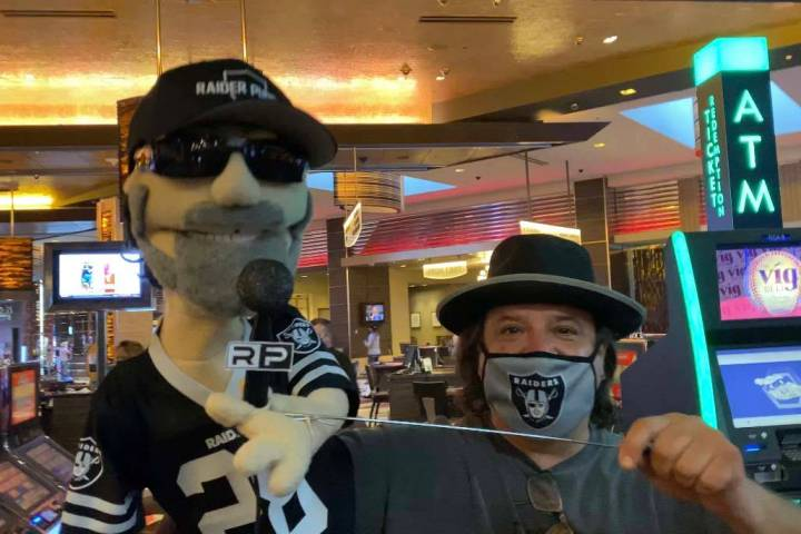 Raider Puppet, left, and ventriloquial practitioner David Michael are shown at Raiders Tavern & ...