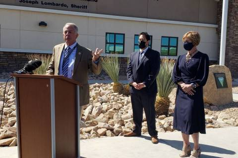 Clark County Sheriff Joe Lombardo, left, speaks alongside Commissioner Michael Naft, center, an ...