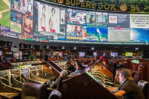 Guests watch the screens at the Westgate sportsbook in Las Vegas, Wednesday, March 3, 2021. (Ra ...