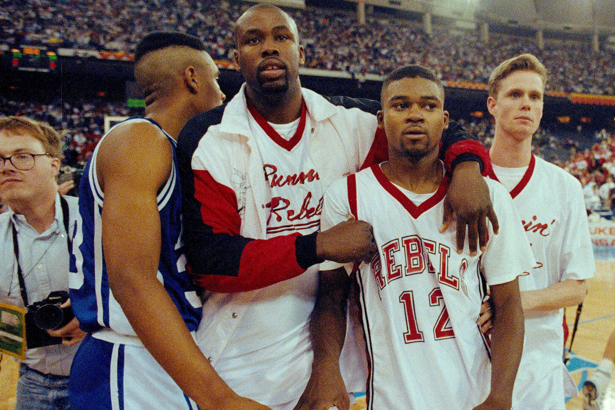 In this March 30, 1991, file photo, UNLV's Anderson Hunt (12) and unidentified teammates leave ...