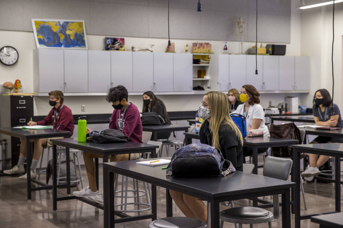 Students keep socially distanced while attending Steve Morrill's anatomy and physiology class a ...