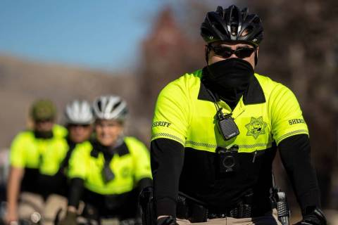 Law enforcement patrol the state Capitol complex on Sunday, Jan. 17, 2021, in Carson City. (Ben ...