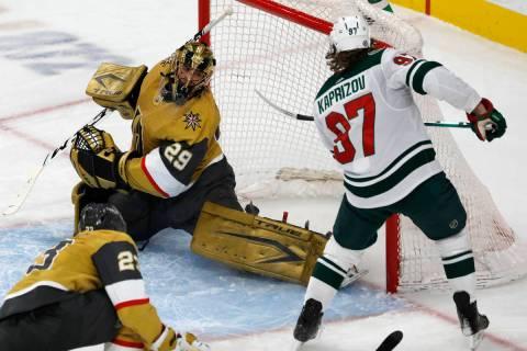 Minnesota Wild left wing Kirill Kaprizov (97) scores against Vegas Golden Knights goaltender Ma ...
