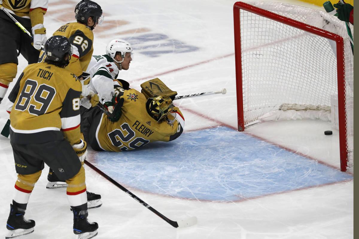 Minnesota Wild center Joel Eriksson Ek (14) scores against Vegas Golden Knights goaltender Marc ...