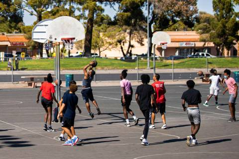 Players play a game of pickup basketball at Sunset Park on Saturday, April 3, 2021, in Las Vega ...