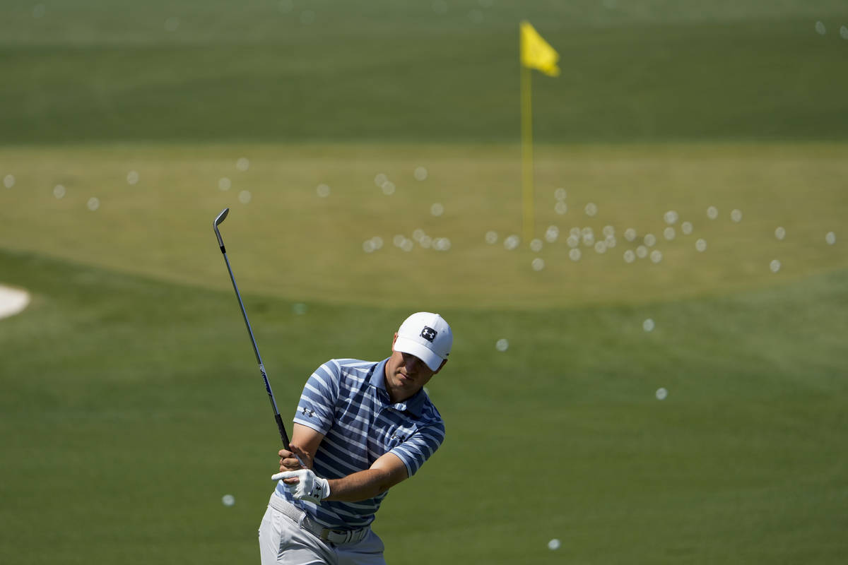 Jordan Spieth works on the range during a practice day for the Masters golf tournament on Monda ...