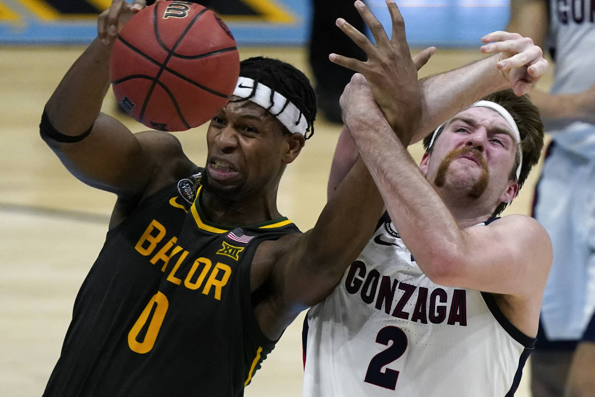 Baylor forward Flo Thamba (0) fights for a rebound with Gonzaga forward Drew Timme (2) during t ...