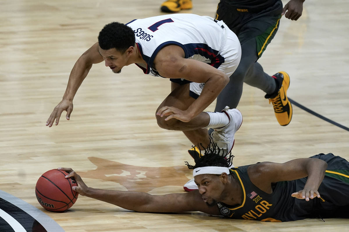 Baylor forward Flo Thamba fights for a loose ball with Gonzaga guard Jalen Suggs (1) during the ...