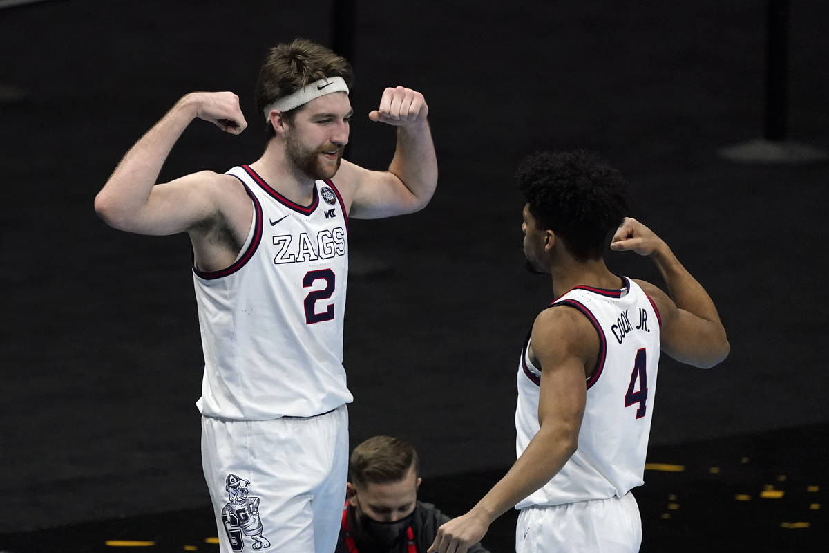 Gonzaga forward Drew Timme (2) celebrates with teammate guard Aaron Cook (4) after making a bas ...