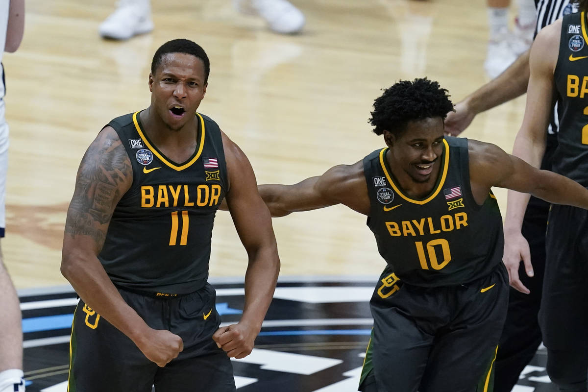Baylor guard Mark Vital (11) celebrates with teammate guard Adam Flagler (10) during a timeout ...
