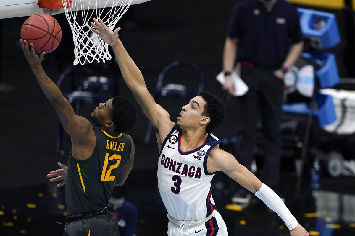 Baylor guard Jared Butler (12) drives to the basket ahead of Gonzaga guard Andrew Nembhard (3) ...