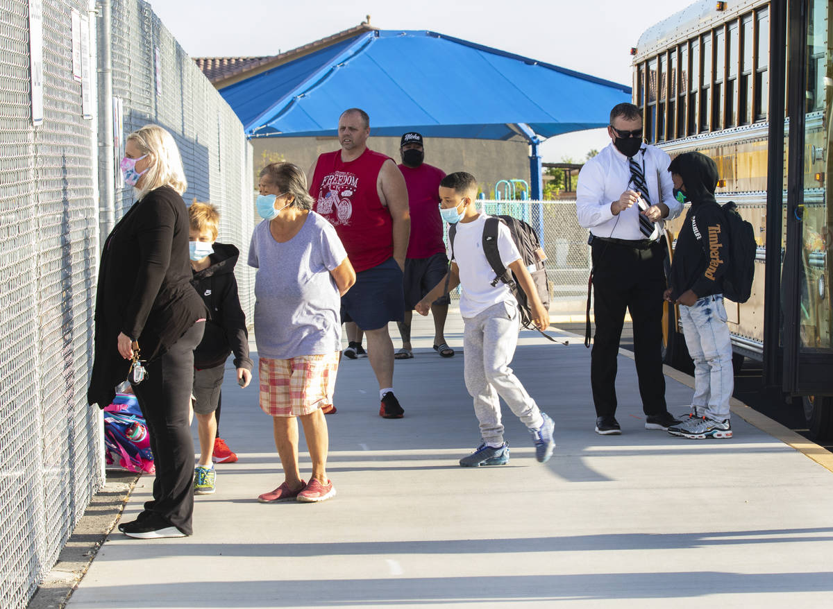 Students arrive at Tyrone Thompson Elementary School for full-time in-person instruction, on Tu ...