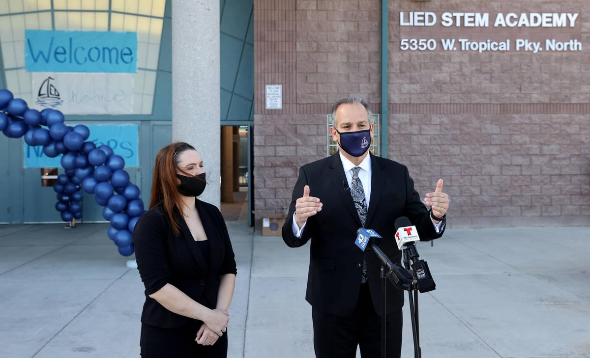 Superintendent Jesus Jara and Trustee Katie Williams talk to the news media after welcoming stu ...
