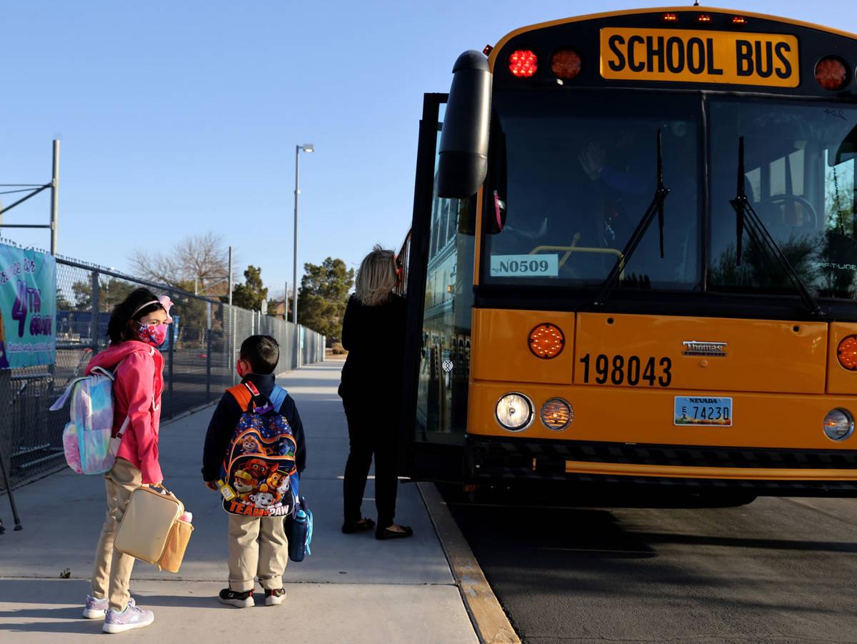 Principal Denise Murray welcomes fourth grader Jasmine Morris, 10, and her brother, kindergartn ...