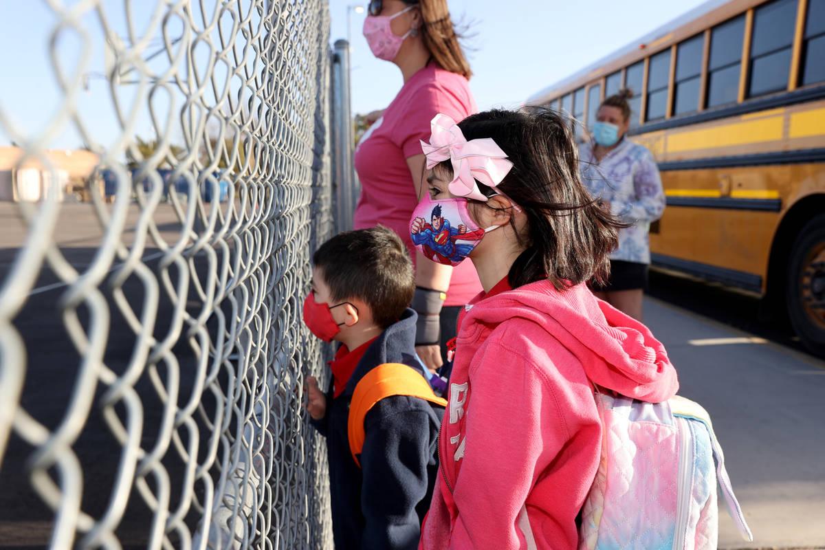 Fourth grader Jasmine Morris, 10, and her brother, kindergartner Daniel Morris, 6, arrive at Ne ...