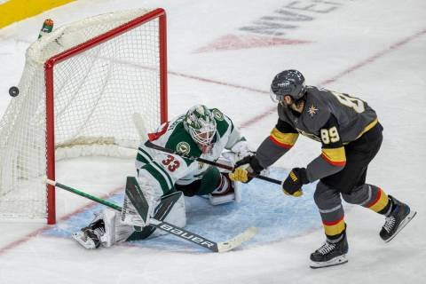 Golden Knights right wing Alex Tuch (89) is unable to score as Minnesota Wild goaltender Cam Ta ...