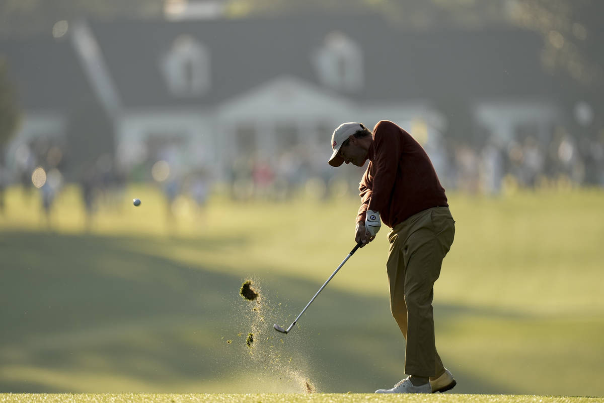 Adam Scott, of Australia, hits from the fairway on the first hole during a practice round for t ...