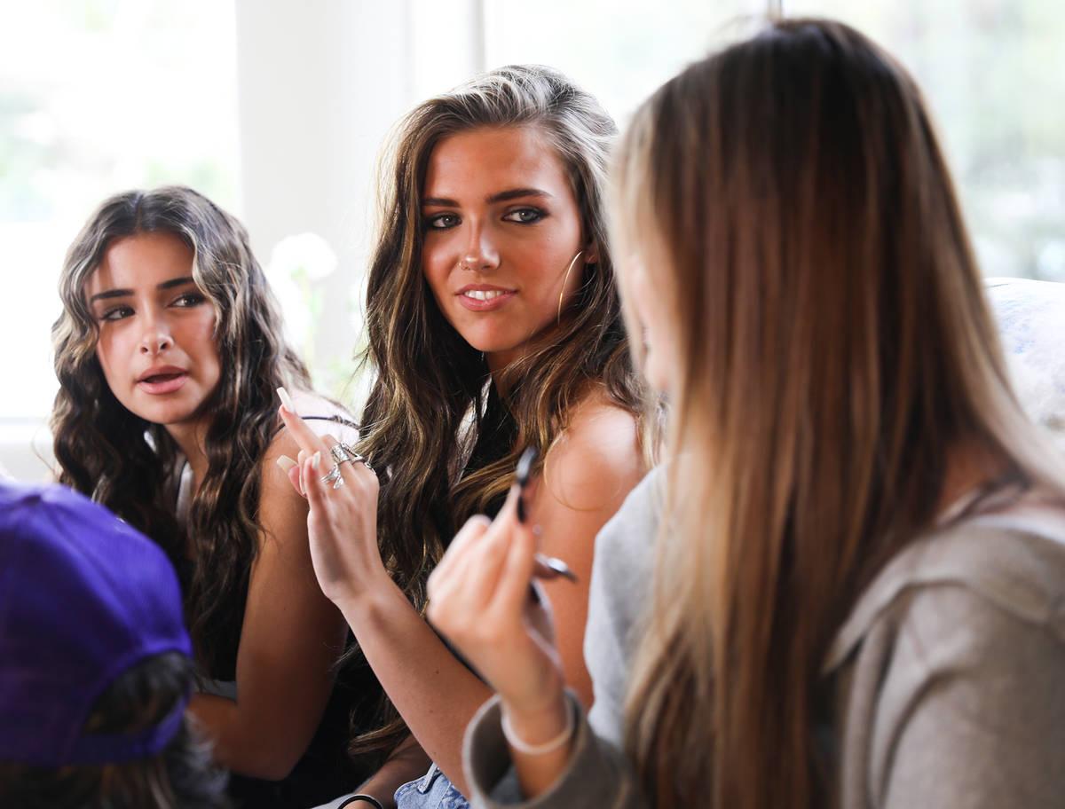 Social media influencers Gabriella Annalisa, 19, from left, faces Jordan Beckham, 16, center, n ...