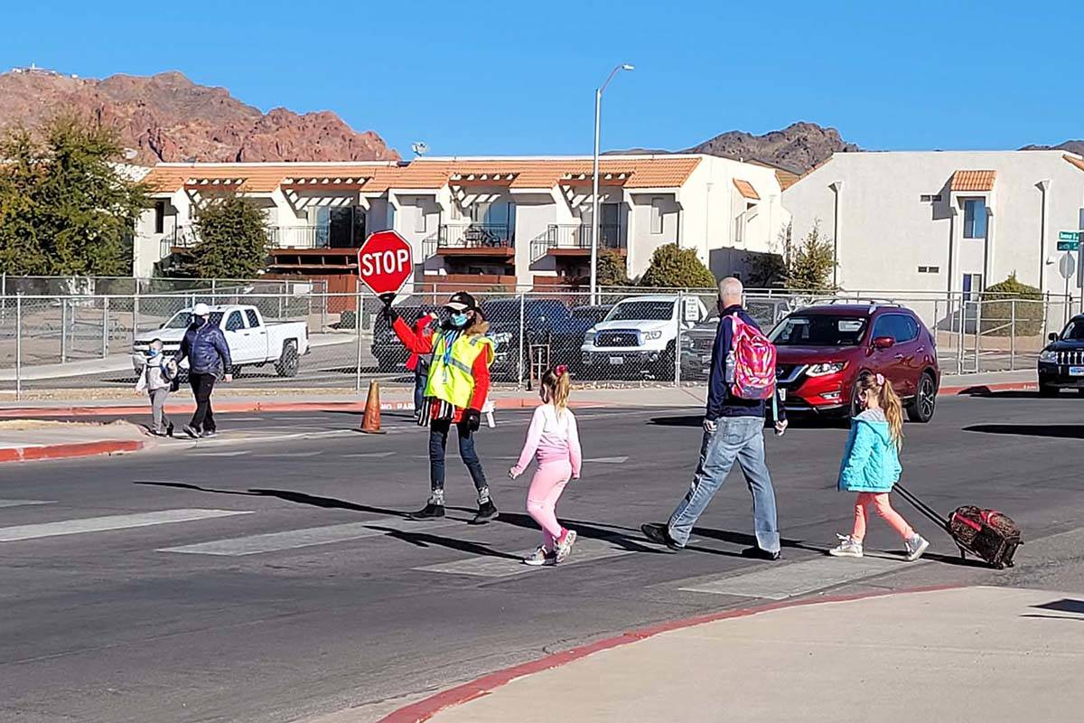 Local crossing guards are back in action helping students arrive to school on the second day of ...