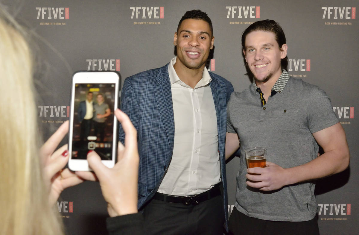 Vegas Golden Knights hockey player Ryan Reaves, left, has his picture taken with teammate Erik ...