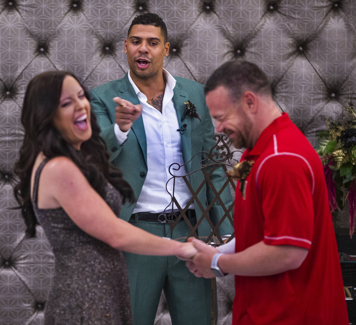 Vegas Golden Knights player Ryan Reaves, center, jokingly counsels the couple as he conducts a ...