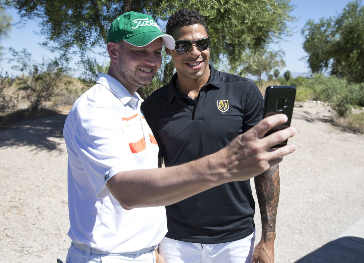 Vegas Golden Knights right wing Ryan Reaves, right, takes a selfie with Knights fan Harley Carb ...
