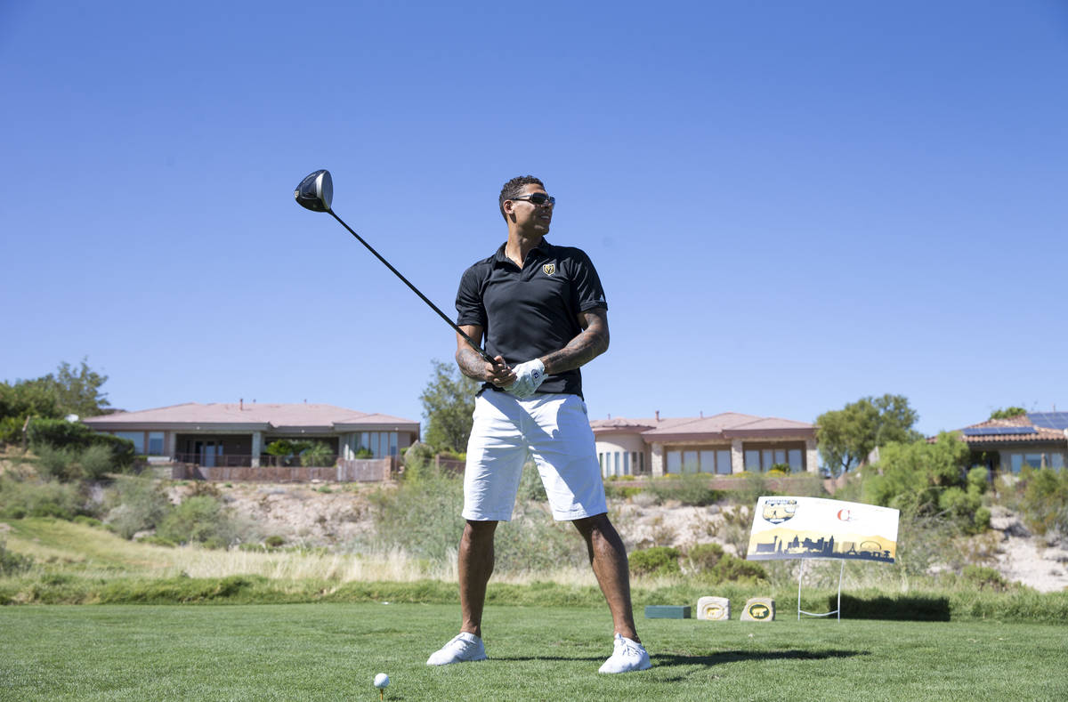 Vegas Golden Knights right wing Ryan Reaves prepares to tee off during the Vegas Golden Knights ...