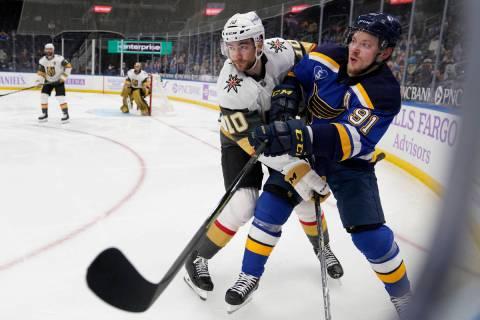 St. Louis Blues' Vladimir Tarasenko, right, gets tangled up with Vegas Golden Knights' Nicolas ...
