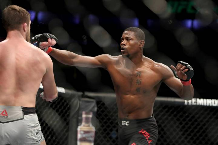 Kevin Holland, right, in action against Gerald Meerschaert during their mixed martial arts bout ...