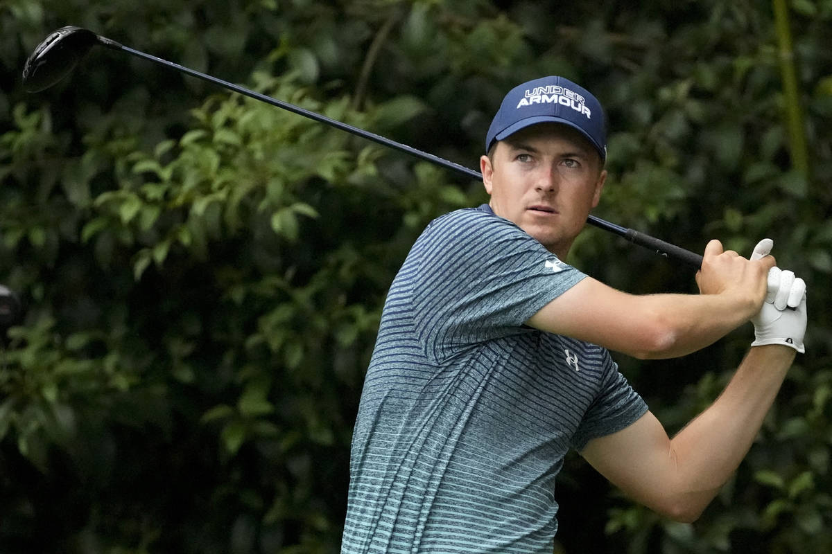 Jordan Spieth watches his drive on the 14th tee during the first round of the Masters golf tour ...