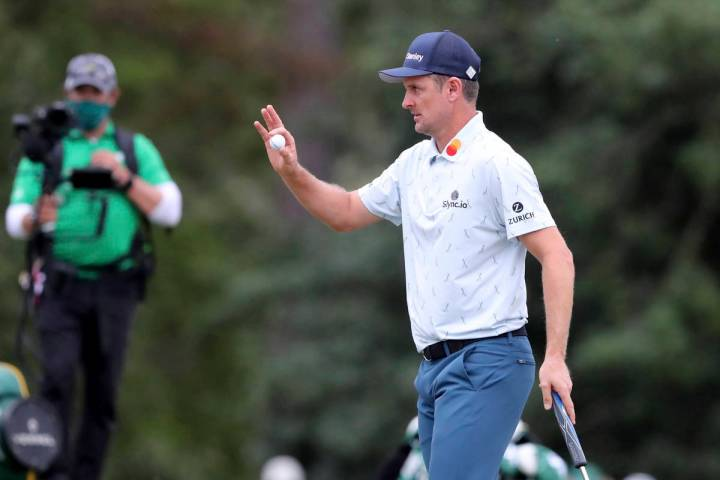 Justin Rose reacts to his birdie shot on the seventeenth hole during the first round of the Mas ...