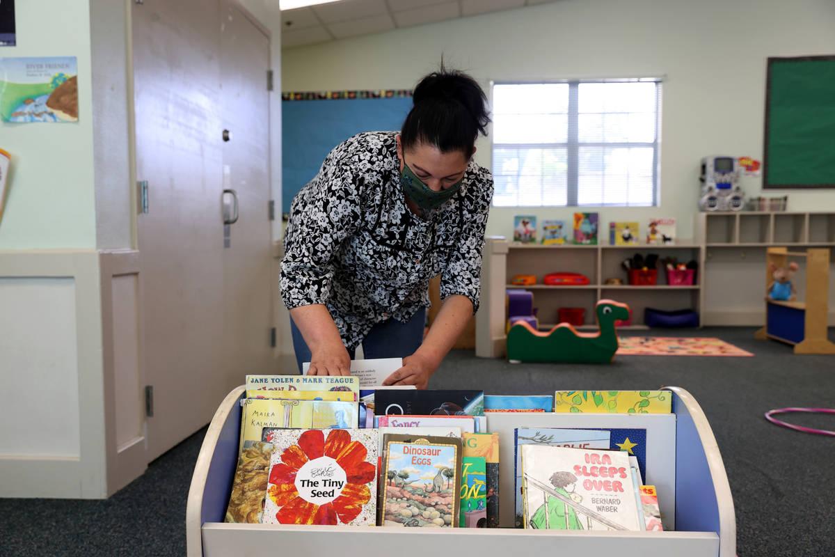 Preschool teacher Alicia Laverdure sets up the gym/multipurpose room at Capstone Christian Acad ...