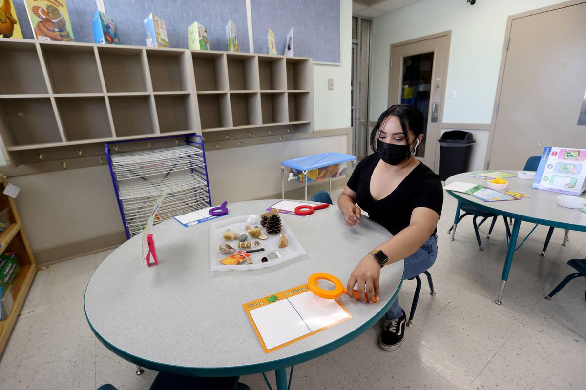 Teachers assistant Angela Hofer sets up a classroom at Capstone Christian Academy in Las Vegas ...