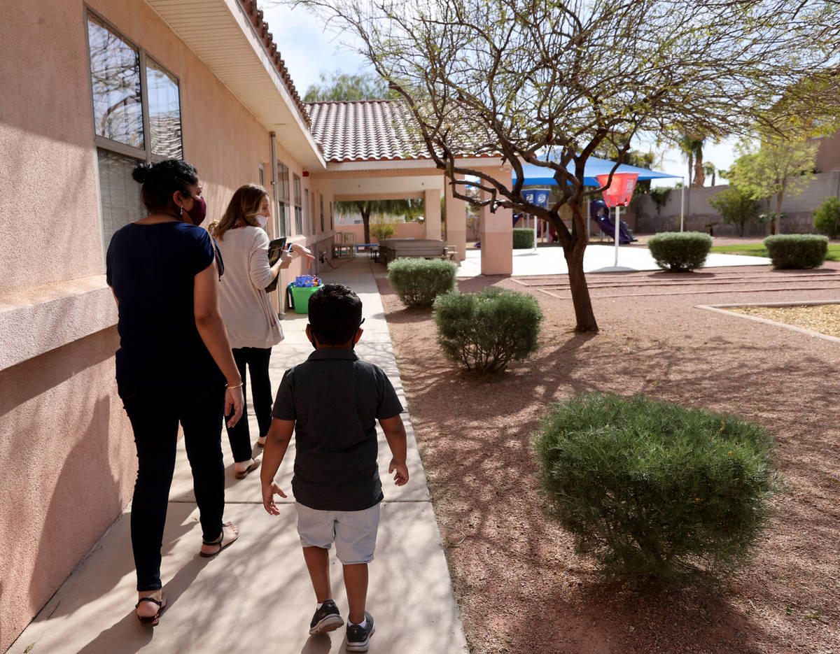 Preschool Director Tracy Kessler gives a tour to Nav Chohan and her son Aydin, 4, at Capstone C ...