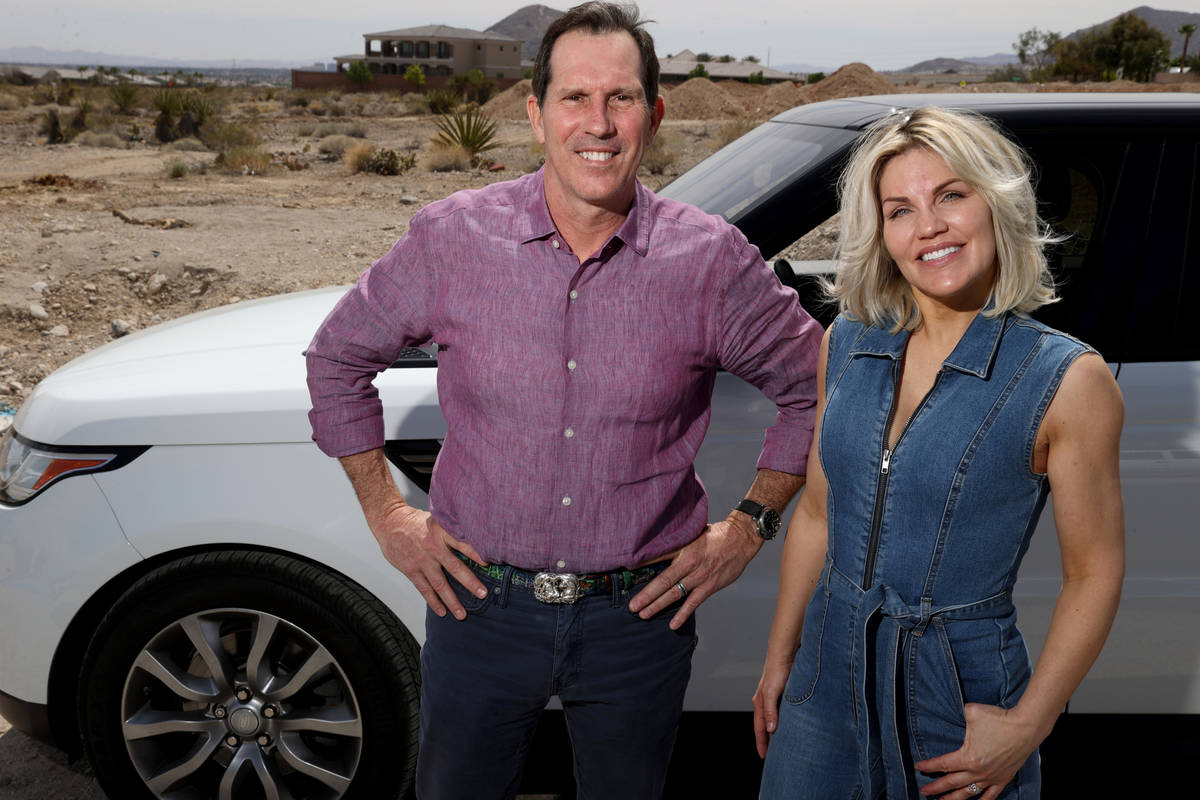 Matthew and Kristyl Addison, who recently sold their house, pose for a photo near the location ...