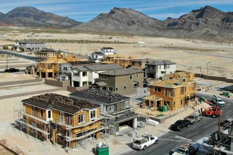 An aerial view of homes under construction in Cascades, a housing development near Far Hills Av ...