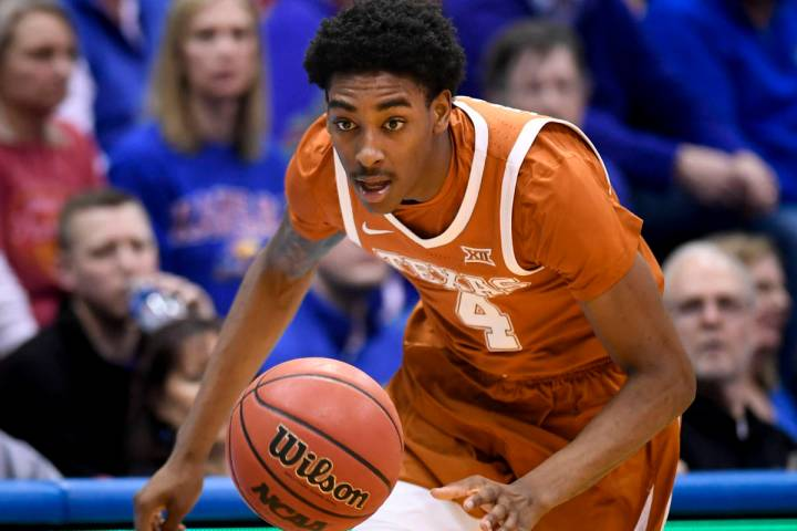 Texas Longhorns guard Donovan Williams (4) chases down a loose ball during the second half of a ...