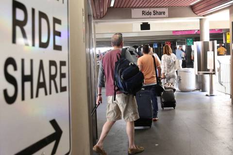 Riders arrive at ride-hailing companies' Uber and Lyft pick up area at McCarran International A ...