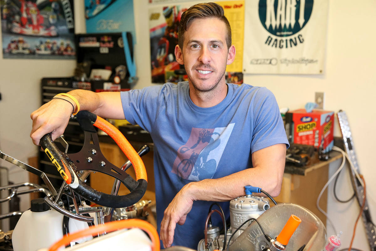 Las Vegas resident and racer instructor Matt Jaskol poses in his garage at his house in Las Veg ...