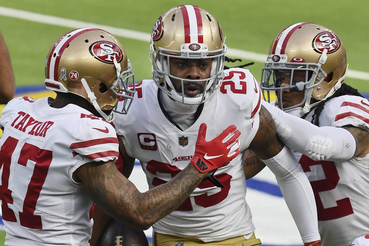 San Francisco 49ers cornerback Richard Sherman (25) is greeted by teammates after Sherman inter ...
