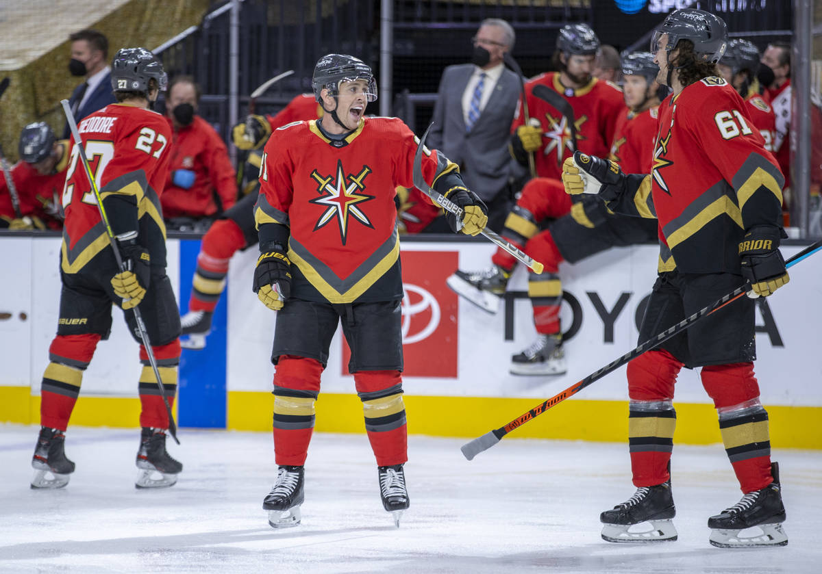 Golden Knights center Jonathan Marchessault (81) celebrates his goal with right wing Mark Stone ...