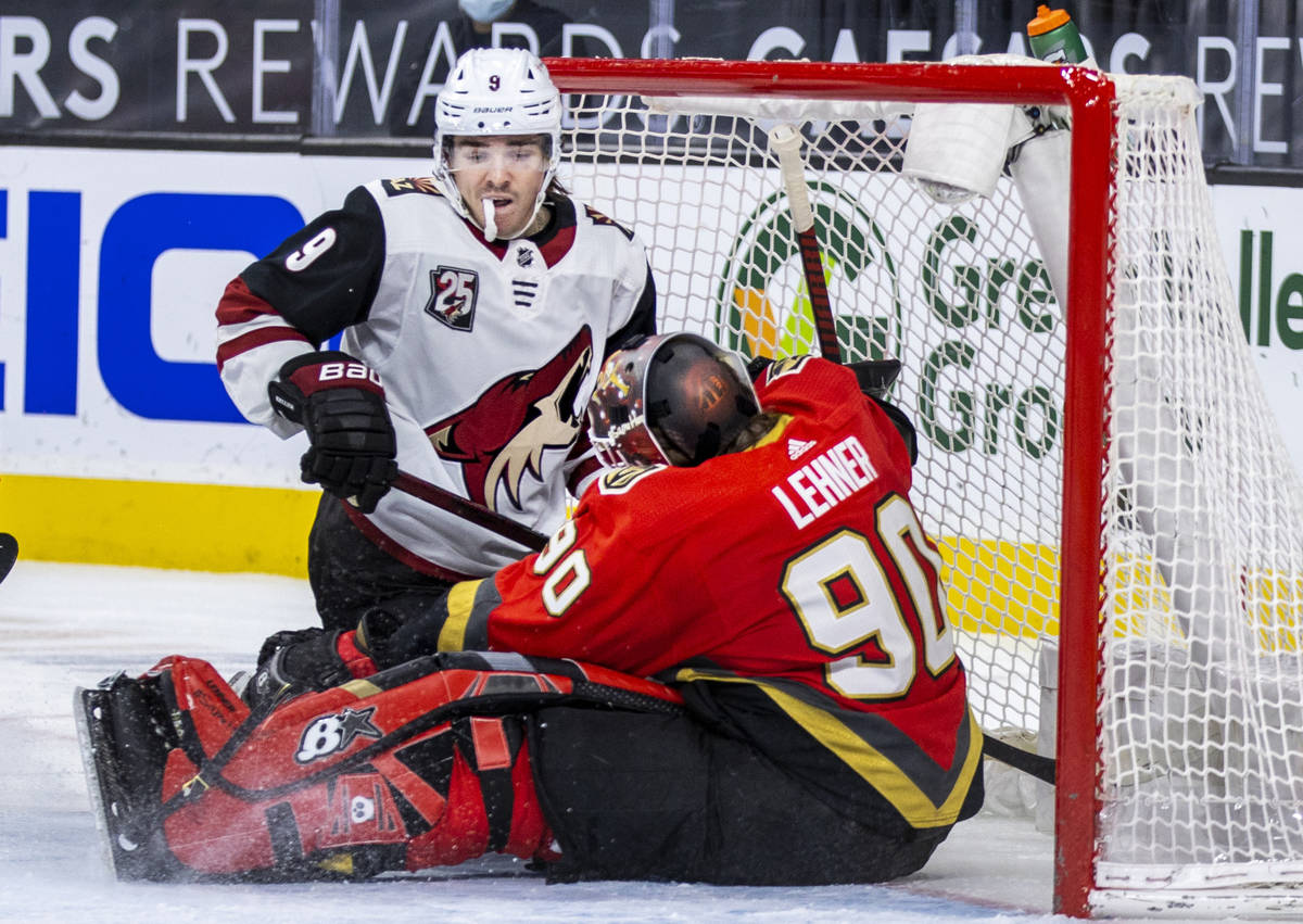 Arizona Coyotes right wing Clayton Keller (9) looks to a stopped puck and Golden Knights goalte ...