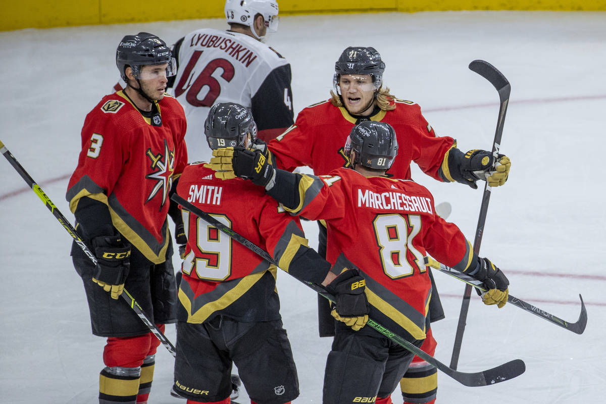 Teammates congratulate Golden Knights right wing Reilly Smith (19) on another goal versus the A ...